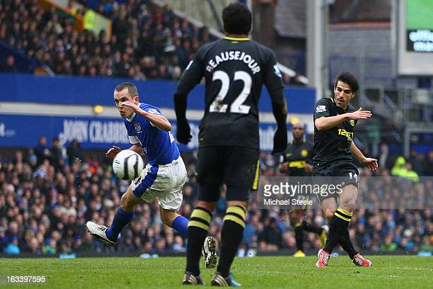 Jordi Gomez of Wigan Athletic scores his sides third goal during the FA Cup Sixth Round match between Everton and Wigan Athletic at Goodison Park on...