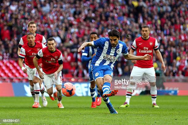 Jordi Gomez of Wigan Athletic scores the first goal from the penalty spot during the FA Cup SemiFinal match between Wigan Athletic and Arsenal at...