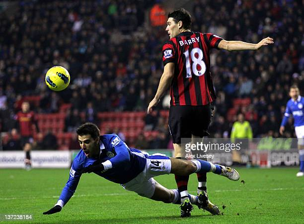 Jordi Gomez of Wigan Athletic tangles with Gareth Barry of Manchester City during the Barclays Premier League match between Wigan Athletic and...