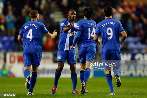 Jordi Gomez of Wigan celebrates after scoring his first goal with team mate Emmerson Boyce during the Barclays Premier League match between Wigan...