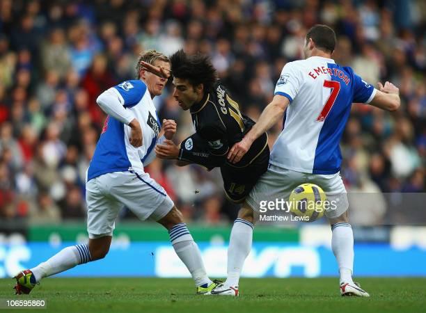Jordi Gomez of Wigan is tackled by Morten Gamst Pedersen and Brett Emerton of Blackburn during the Barclays Premier League match between Blackburn...