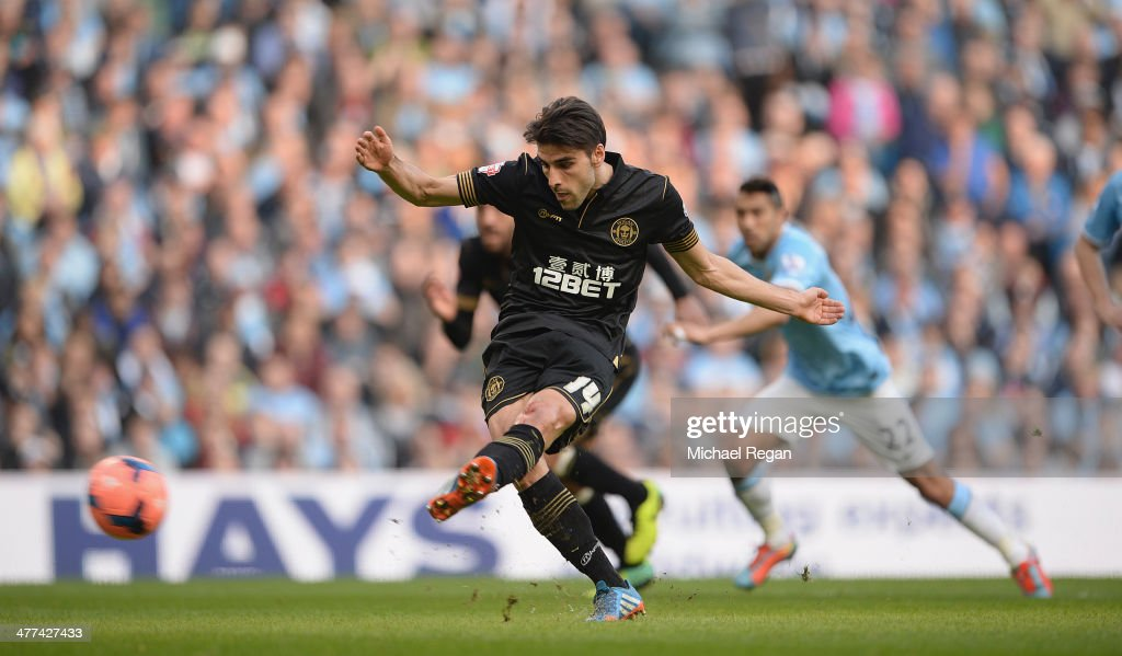 Jordi Gomez of Wigan scores a penalty to make it 1-0 during the FA Cup Quarter-Final match between Manchester City and Wigan Athletic at the Etihad Stadium on March 9, 2014 in Manchester, England.