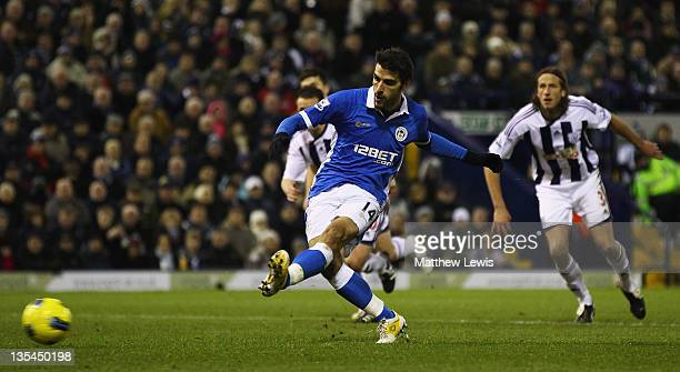 Jordi Gomez of Wigan scores from the penalty spot during the Barclays Premier League match between West Bromwich Albion and Wigan Athletic at The...