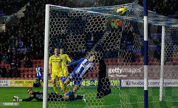 Jordi Gomez of Wigan scores his first goal during the Barclays Premier League match between Wigan Athletic and Reading at the DW Stadium on November...