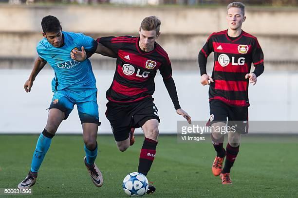 Jordi Mboula of Fc Barcelona U19 Jonas Carls of Bayer 04 Leverkusen U19 during the UEFA Youth League match between Bayer 04 Leverkusen U19 and...