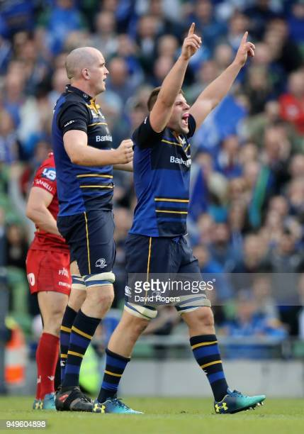 Jordi Murphy of Leinster celebrates with team mate Devin Toner after their victory during the European Rugby Champions Cup SemiFinal match between...