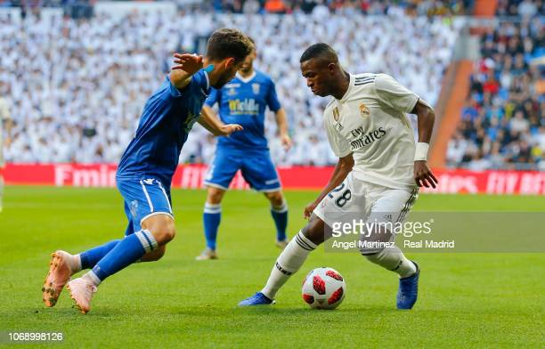 Jordi Ortega of Real Madrid competes for the ball with Jordi Ortega of Melilla during the Copa del Rey fourth round second leg match between Real...