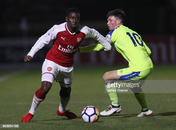 Jordi Osei Tutu of Arsenal takes the ball past Charles Vernam of Derby during the Premier League 2 match between Arsenal and Derby County at Meadow...