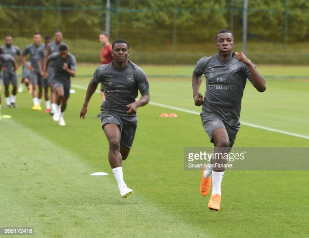 Jordi OseiTutu and Eddie Nketiah of Arsenal during a training session at London Colney on July 10 2018 in St Albans England