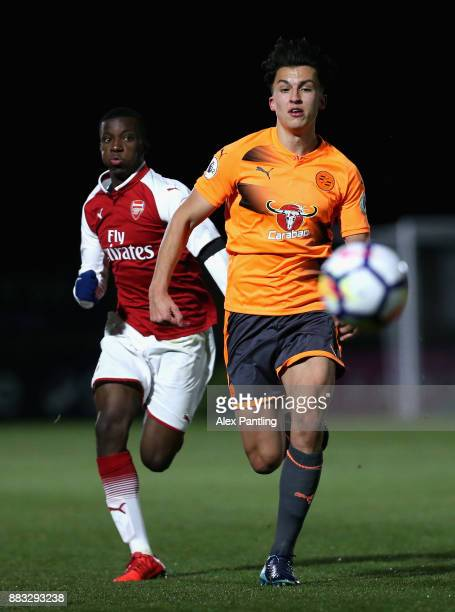 Jordi OseiTutu of Arsenal and Tom McIntyre of Reading chase the ball during the Premier League International Cup match between Arsenal and Reading at...