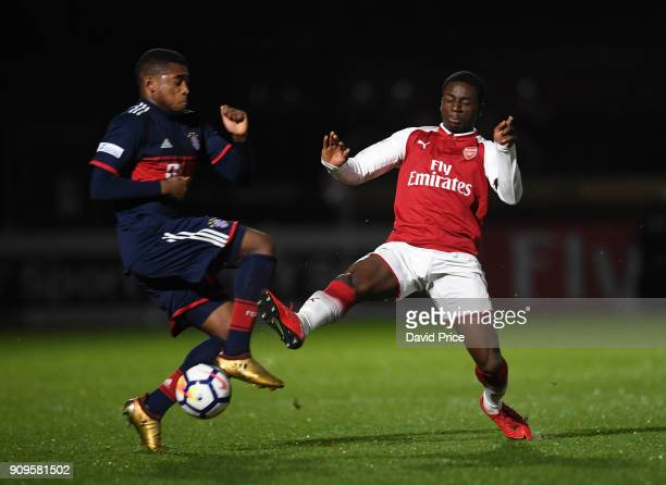 Jordi OseiTutu of Arsenal challenges Franck Evina of Bayern during the Premier League International Cup Match between Arsenal and Bayern Munich at...