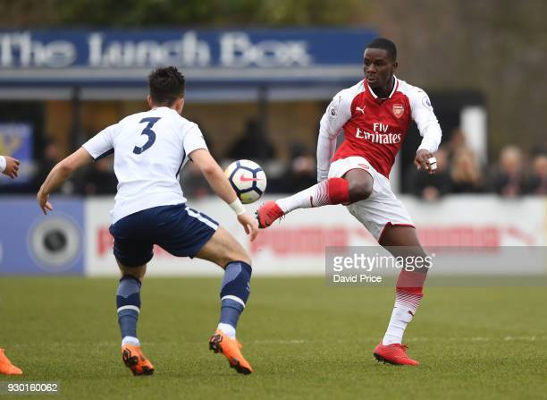 Jordi OseiTutu of Arsenal knocks the ball past Anthony Georgiou of Tottenham during the match between Arsenal and Tottenham Hotspur at Meadow Park on...