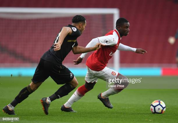 Jordi OseiTutu of Arsenal takes on Kenji Gorre of Swansea during the match between Arsenal U23 and Swansea U23 at Emirates Stadium on April 13 2018...