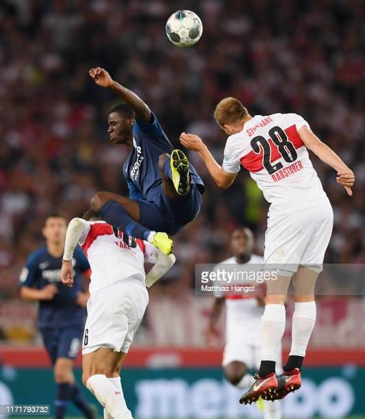 Jordi OseiTutu of Bochum jumps for a header with Atakan Karazor of VfB Stuttgart and Holger Badstuber of VfB Stuttgart during the Second Bundesliga...