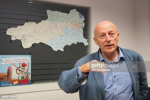 Jordi Vera coordinator of Catalan party 'Si al pais Catala' speaks in front of a map of PyreneesOrientales department which borders Spain in...