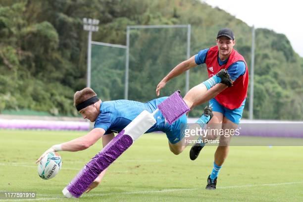 Jordie Barrett and George Bridge of the All Blacks run through drills during a New Zealand training session at Jissoji Tamokuteki Ground on September...