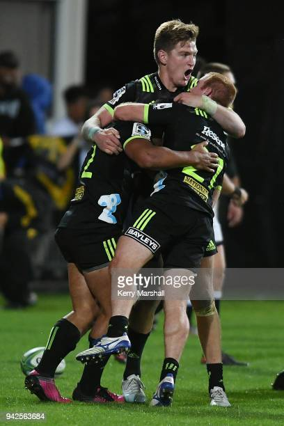 Jordie Barrett celebrates the match winning try with other Hurricanes team members during the round eight Super Rugby match between the Hurricanes...