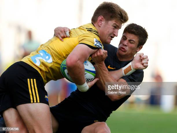 Jordie Barrett of Hurricanes is tackled by Bautista Delguy of Jaguares during a match between Jaguares and Hurricanes as part of third round of Super...