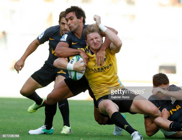 Jordie Barrett of Hurricanes is tackled by Matias Orlando of Jaguares during a match between Jaguares and Hurricanes as part of third round of Super...