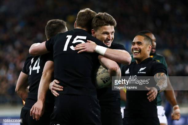 Jordie Barrett of New Zealand celebrates with Beauden Barrett and Aaron Smith after scoring a try during The Rugby Championship match between the New...