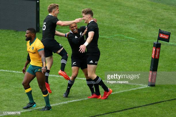 Jordie Barrett of the All Blacks celebrates scoring a try with team mates Aaron Smith and Damian McKenzie during the Bledisloe Cup match between the...