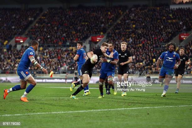 Jordie Barrett of the All Blacks fends off Mathieu Babillot of France on his way to score a try during the International Test match between the New...