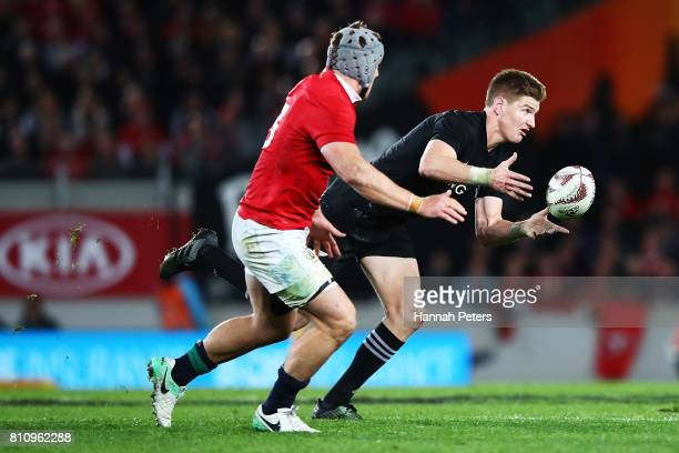 Jordie Barrett of the All Blacks offloads the ball during the Test match between the New Zealand All Blacks and the British Irish Lions at Eden Park...