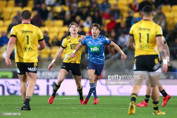 Jordie Barrett of the Hurricanes and Beauden Barrett of the Blues compete during the round 6 Super Rugby Aotearoa match between the Hurricanes and...