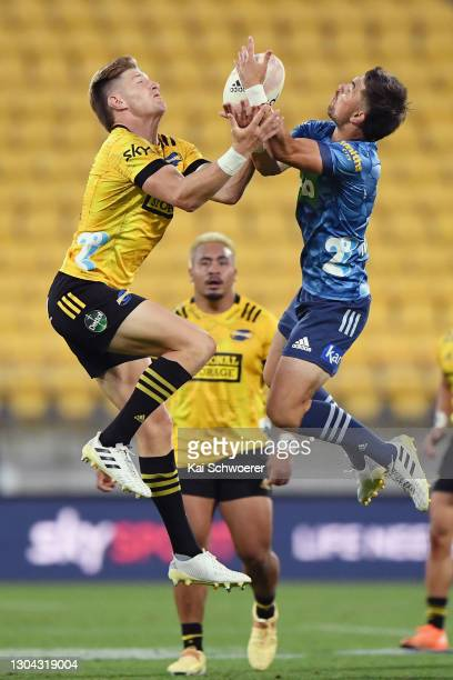 Jordie Barrett of the Hurricanes and Otere Black of the Blues compete for the ball during the round one Super Rugby Aotearoa match between the...