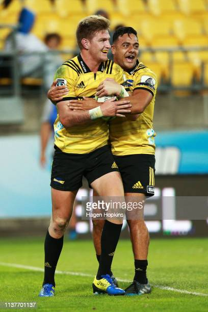 Jordie Barrett of the Hurricanes celebrates with Chase Tiatia after scoring a try during the round six Super Rugby match between the Hurricanes and...