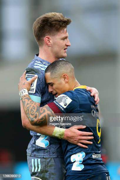 Jordie Barrett of the Hurricanes embraces Aaron Smith of the Highlanders after the round 10 Super Rugby Aotearoa match between the Highlanders and...