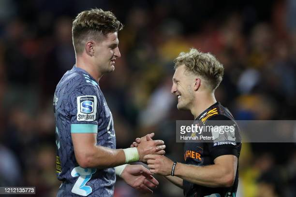 Jordie Barrett of the Hurricanes is congratulated by Damian McKenzie of the Chiefs after winning the round seven Super Rugby match between the Chiefs...