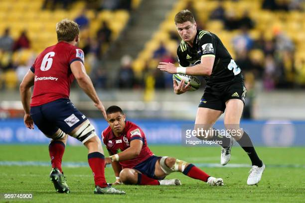 Jordie Barrett of the Hurricanes looks to evade Angus ScottYoung of the Reds during the round 14 Super Rugby match between the Hurricanes and the...