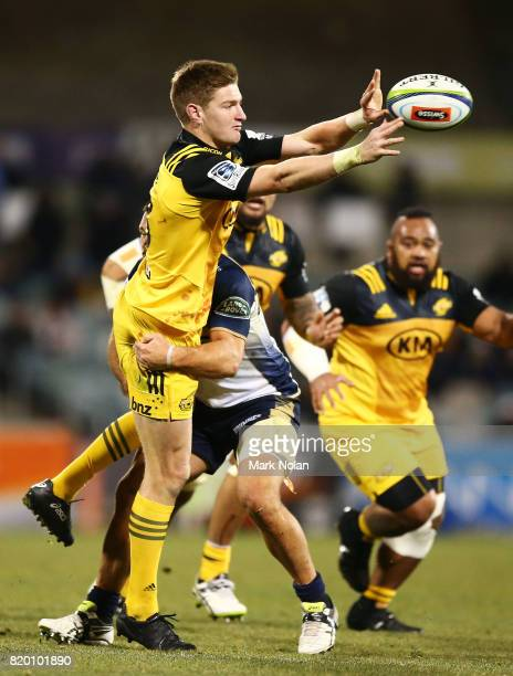 Jordie Barrett of the Hurricanes offloads during the Super Rugby Quarter Final match between the Brumbies and the Hurricanes at Canberra Stadium on...