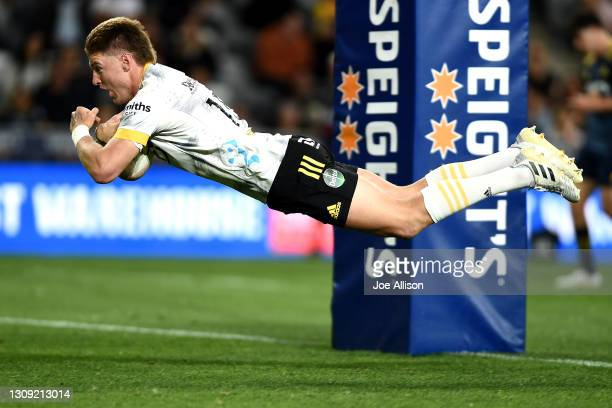 Jordie Barrett of the Hurricanes scores a try during the round 5 Super Rugby Aotearoa match between the Highlanders and the Hurricanes at Forsyth...
