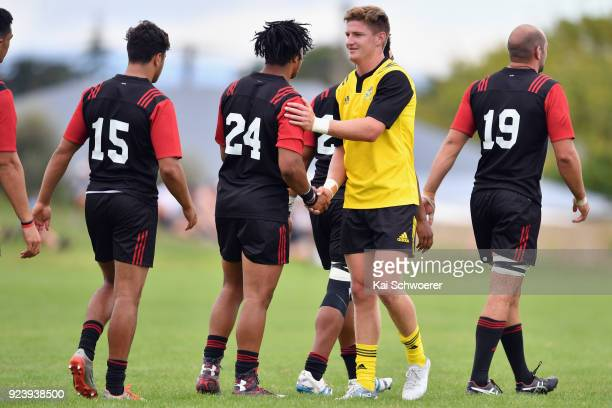 Jordie Barrett of the Hurricanes shakes hands with Crusaders Knights players after the win in the match between the Crusaders Knights and the...