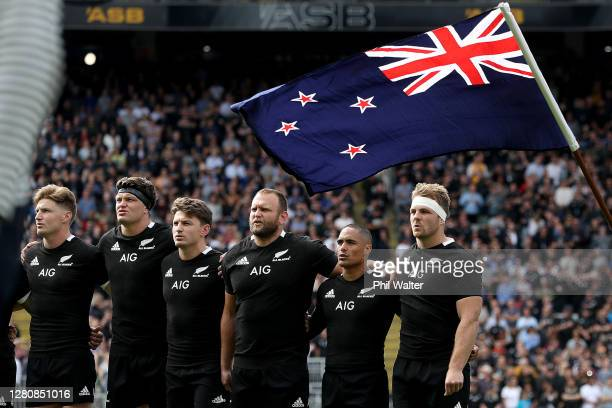 Jordie Barrett, Scott Barrett, Beauden Barrett, Joe Moody, Aaron Smith and Sam Cane of the All Blacks sing the anthem before the Bledisloe Cup match...