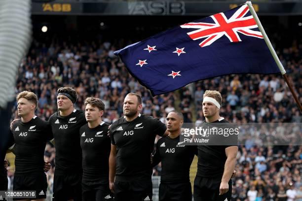 Jordie Barrett, Scott Barrett, Beauden Barrett, Joe Moody, Aaron Smith and Sam Cane of the All Blacks sing the anthem before the Bledisloe Cup match...