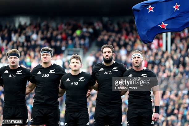 Jordie Barrett Scott Barrett Beauden Barrett Samuel Whitelock and Kieran Read of the All Blacks sing the national anthem ahead of the rugby Test...