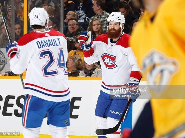 Jordie Benn celebrates his goal with Phillip Danault of the Montreal Canadiens against the Nashville Predators during an NHL game at Bridgestone...