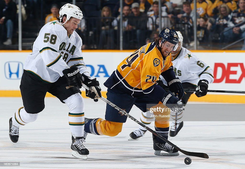 Jordie Benn #58 of the Dallas Stars battles for the puck against Matt Halischuk #24 of the Nashville Predators during an NHL game at the Bridgestone Arena on February 25, 2013 in Nashville, Tennessee.