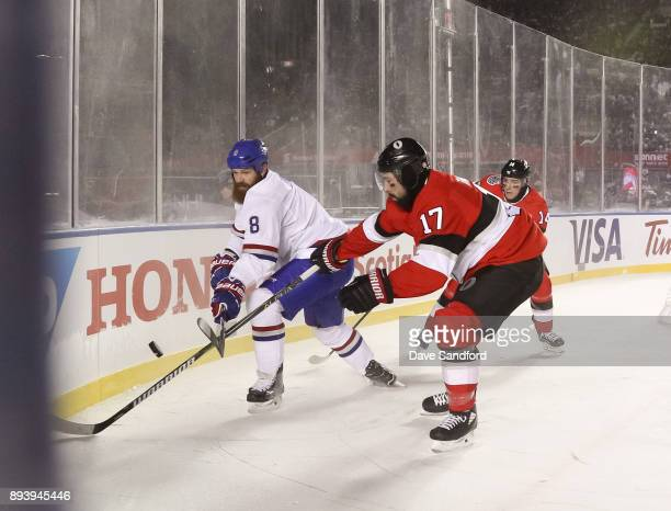 Jordie Benn of the Montreal Canadiens battles for a loose puck with Nate Thompson of the Ottawa Senators during the 2017 Scotiabank NHL100 Classic at...