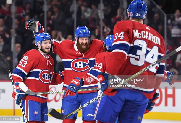 Jordie Benn of the Montreal Canadiens celebrates with teammates after scoring a goal against of the Vegas Golden Knights in the NHL game at the Bell...