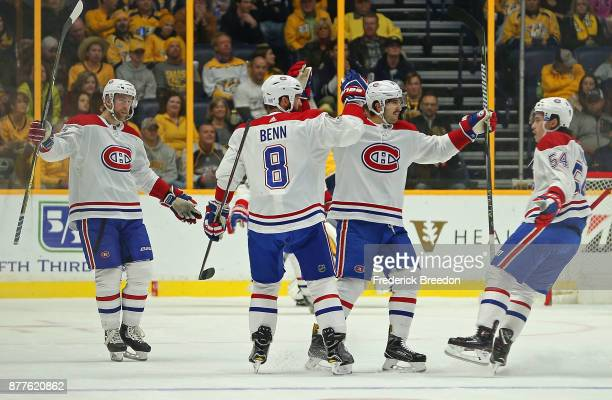 Jordie Benn of the Montreal Canadiens celebrates with teammates after scoring a goal against the Nashville Predators during the first period at...