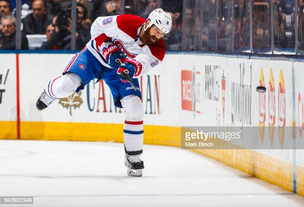 Jordie Benn of the Montreal Canadiens clears the puck against the Toronto Maple Leafs during the second period at the Air Canada Centre on April 7...
