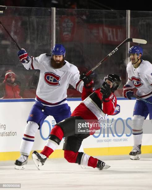 Jordie Benn of the Montreal Canadiens collides with Matt Duchene of the Ottawa Senators during the 2017 Scotiabank NHL100 Classic at Lansdowne Park...