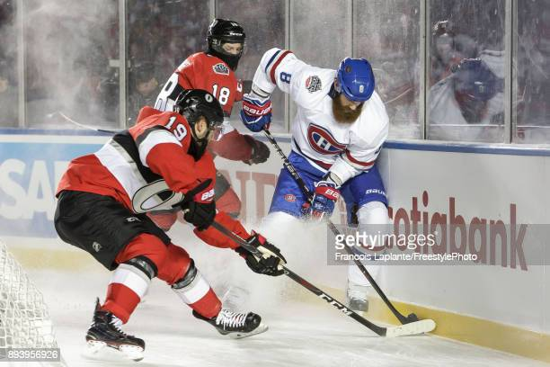 Jordie Benn of the Montreal Canadiens controls the puck against Derick Brassard and Ryan Dzingel of the Ottawa Senators at the 2017 Scotiabank NHL...