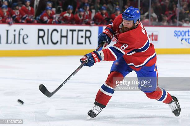 Jordie Benn of the Montreal Canadiens fires a shot against the Pittsburgh Penguins in the NHL game at the Bell Centre on March 2 2019 in Montreal...