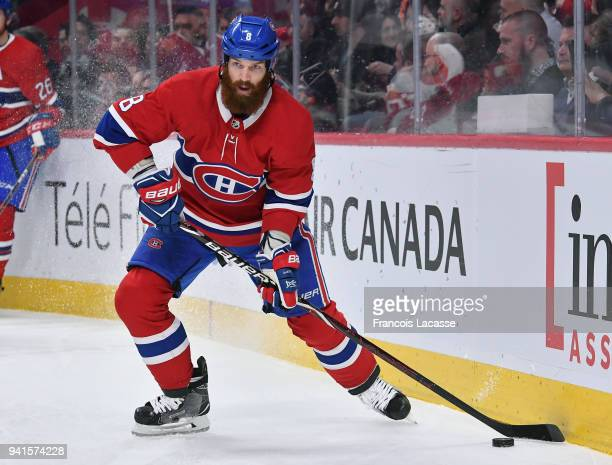 Jordie Benn of the Montreal Canadiens looks to pass the puck against the Detroit Red Wings in the NHL game at the Bell Centre on March 26 2018 in...