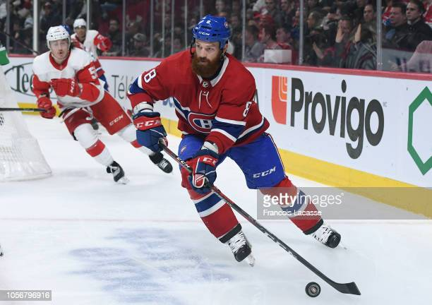 Jordie Benn of the Montreal Canadiens passes the puck against the Detroit Red Wings in the NHL game at the Bell Centre on October 15 2018 in Montreal...